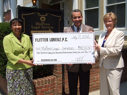 Rhodia Thomas of MidPenn Receives Check from Cary Flitter, Esq. Consumer Attorney Nancy Datres is also pictured.
